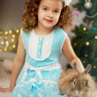 Little cute сhristmas girl with bunny — Stock Photo