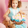 Little cute easer girl with bunny — Stock Photo #27082635