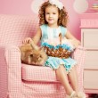 Stock Photo: Little cute easer girl with bunny