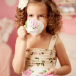 Little sweet girl with tea — Stock Photo