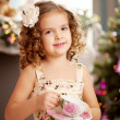 Stock Photo: Little sweet girl with tea