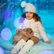 Little winter girl with rabbit — Stock Photo #27082783