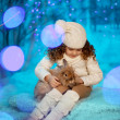 Stock Photo: Little winter girl with rabbit