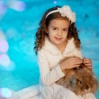 Little winter girl with rabbit — Stock Photo #27082837