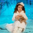 Little winter girl with rabbit — Stock Photo #27082841