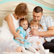 Happy family smiling at home — Stock Photo #27083209