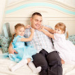 Stock Photo: Happy family smiling at home