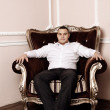 Man in a luxurious armchair — Stock Photo