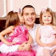 Happy family smiling at home — Stock Photo #27083413