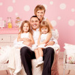 Happy family smiling at home — Stock Photo