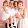 Happy family smiling at home — Stock Photo #27083513