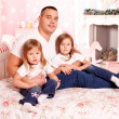 Happy family smiling at home — Stockfoto