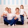 Happy family smiling at home — Stock Photo #27083601