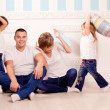 Happy family smiling at home — Stock Photo #27083609
