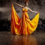 Luxury lady in silk dress — Stock Photo #27083981
