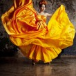Lady in flying silk dress — Stock Photo #27084013