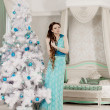 Fashion christmas woman in luxury interior — Stok fotoğraf