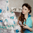 Luxury christmas woman in fashion interior — Stock Photo