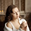 Beautiful woman with a candle — Stock Photo #27085241