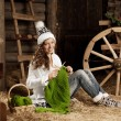 Woman in the village barn with knitting in hand — Stock Photo #27085279