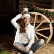 Smiling woman in the village barn — Stock Photo #27085291