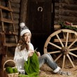 Stock Photo: Womin village barn with knitting in hand
