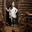 Smiling woman in the village barn — Stock Photo #27085327