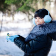 Young woman feeding winter birds — Stock Photo