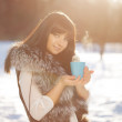 Stock Photo: Young woman with a cup of hot drink