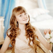 Young beautiful woman in a bedroom — Stock Photo
