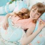 Cute young girl in nice children's bedroom — Stock Photo