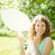 Woman holding white bubble talk in summer park — Stock Photo