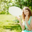 Woman holding white bubble talk in summer park  — Lizenzfreies Foto