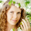 Stock Photo: Young woman in blooming garden