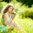 Happiness young woman in field of flowers — Stockfoto