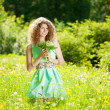 Happiness young woman in field of flowers — Foto de Stock