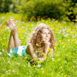 Stock Photo: Happiness young woman in field of flowers
