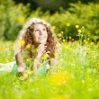 Happiness young woman in field of flowers — Stock Photo #27086617
