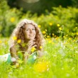 Happiness young woman in field of flowers — Stok fotoğraf
