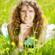 Happiness young woman in field of flowers — Stock Photo #27086629