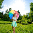 Happiness young woman with rainbow umbrella — Stock Photo