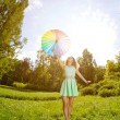 Happiness young woman with rainbow umbrella — Stock Photo #27086693