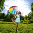 Happiness young woman with rainbow umbrella — Stock Photo #27086701