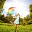 Happiness young woman with rainbow umbrella — Stock Photo #27086711