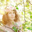 Young beauty woman in blooming garden — Stock Photo #27086727