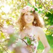 Stock Photo: Young beauty womin blooming garden