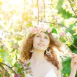 Young beauty woman in blooming garden — Stock Photo #27086749