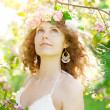 Young beauty woman in blooming garden — Stock Photo