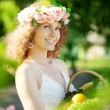 Woman with a basket of fruit in hand — Stock Photo #27086869