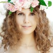 Young beauty woman in blooming garden — Stock Photo #27086907